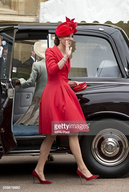 Catherine Duchess of Cambridge waves to the crowd as she arrives for the Order of The Garter Service at Windsor Castle on June 13 2016 in Windsor...