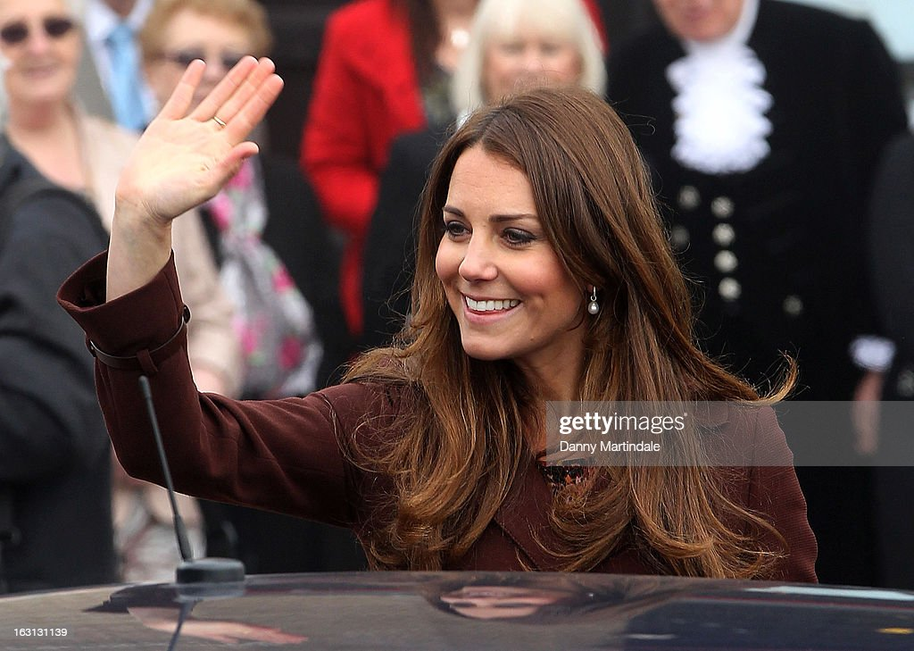 Catherine, Duchess of Cambridge waves to the crowd during her visit to the National Fishing Heritage Centre during her official visit to Grimsby on March 5, 2013 in Grimsby, England.