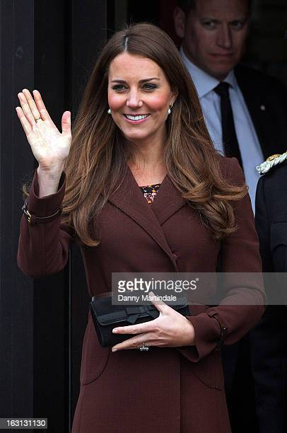 Catherine Duchess of Cambridge waves to the crowd during her visits to the National Fishing Heritage Centre during her official visit to Grimsby on...