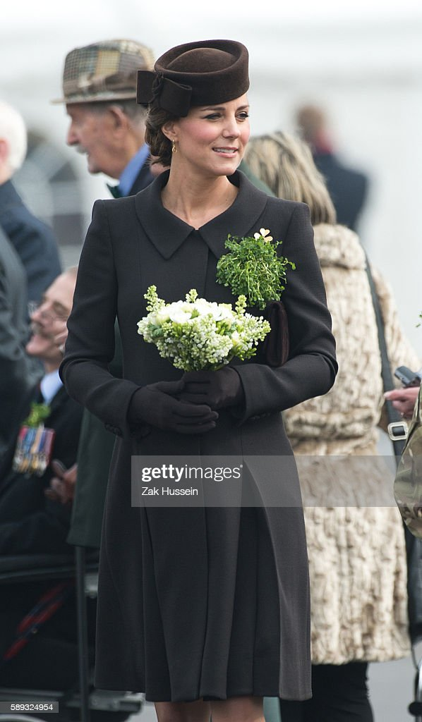 Catherine Duchess of Cambridge wearing a bespoke Catherine Walker coat attending the Irish Guards' St Patrick's Day Parade at Mons Barracks in...