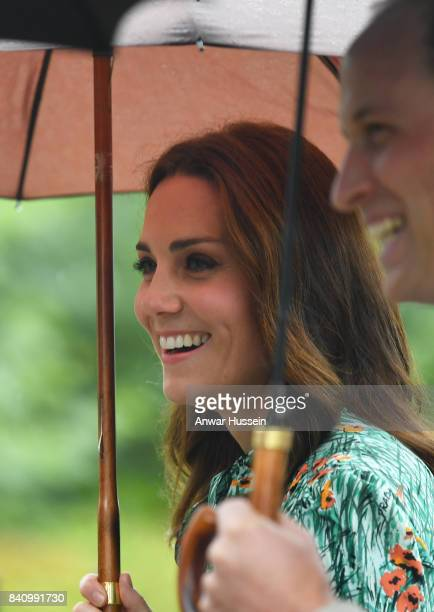 Catherine Duchess of Cambridge wearing a floral print dress by Prada and Prince William Duke of Cambridge visit The White Garden in Kensington Palace...