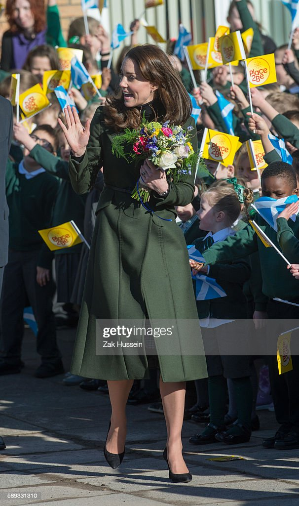 Catherine Duchess of Cambridge wearing a green MaxMara coat visits St Catherine's Primary School in Edinburgh Scotland
