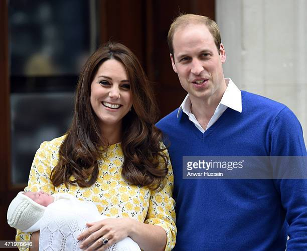 Catherine Duchess of Cambridge wearing a Jenny Packham dress and Prince William Duke of Cambridge leave the Lindo Wing at St Mary's Hospital with...