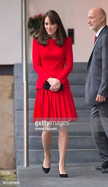 Catherine Duchess of Cambridge wearing a red Alexander McQueen dress attends the Anna Freud Centre Family School Christmas Party at the Anna Freud...