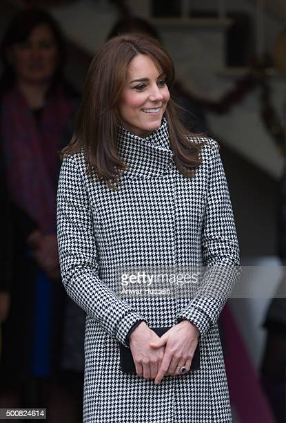 Catherine Duchess of Cambridge wearing a 'Rubik' coat by Reiss attends an official visit to the Action on Addiction Centre for addiction treatment...