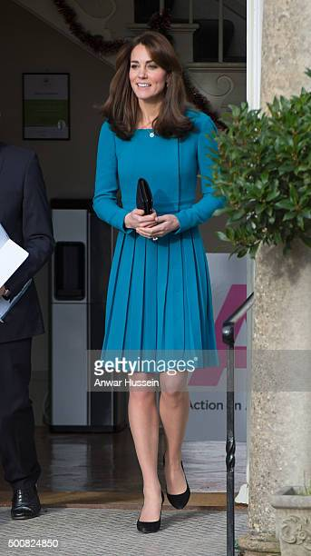 Catherine Duchess of Cambridge wearing a turquoise Emilia Wickstead dress attends an official visit to the Action on Addiction Centre for addiction...
