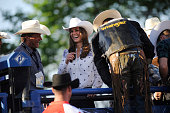 Catherine Duchess of Cambridge wears her new Smithbilt cowboy hat as she watches a rodeo demonstration at a Government Reception at the BMO Centre on...