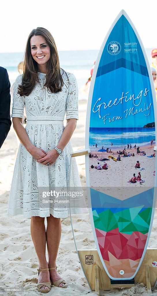 Catherine, Duchess of Cambridge with a surfboard as she attends a lifesaving event on Manley Beach on April 18, 2014 in Sydney, Australia. The Duke and Duchess of Cambridge are on a three-week tour of Australia and New Zealand, the first official trip overseas with their son, Prince George of Cambridge.