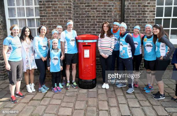Catherine Duchess of Cambridge with Alex Stanley and runners as they put a Heads Together headband onto the Kensington Palace postbox in support of...