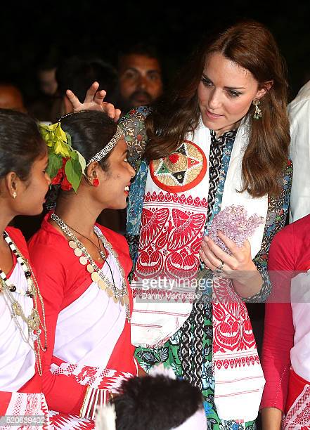 Catherine Duchess of Cambridge with dancers by the fireside during a Bihu Festival Celebration at Diphlu River Lodge on day 3 of the royal visit to...