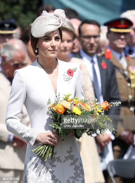 Catherine Duchess of Cambridge with flowers during a ceremony at the Commonwealth War Graves Commisions's Tyne Cot Cemetery on July 31 2017 in Ypres...