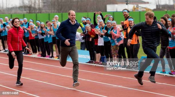 Catherine Duchess of Cambridge with Prince Harry and Prince William Duke of Cambridge take part in a race during a training day for the Heads...