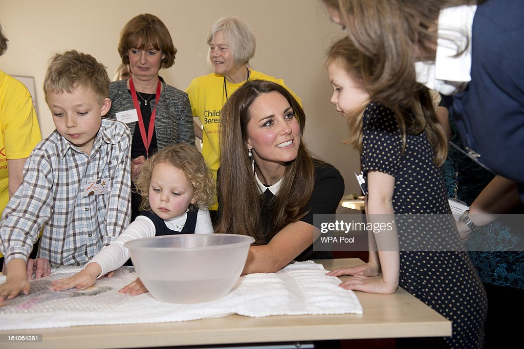 Catherine, Duchess of Cambridge with recently bereaved children William Howitt, 8, Geogina Howitt, 6 and Beatrice Howitt, 3, as she visits the offices of Child Bereavement UK on March 19, 2013 in Saunderton, Buckinghamshire.