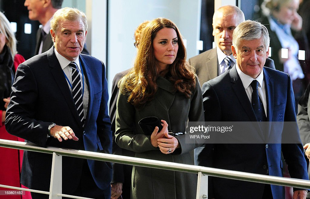 Catherine, Duchess of Cambridge with Trevor Brooking and David Bernstein (right) during the official launch of The Football Association's National Football Centre at St George's Park on October 9, 2012 in Burton-upon-Trent, England.
