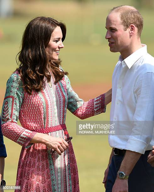 Catherine Duchess of Cambridgeand Britain's Prince William Duke of Cambridge speak as they play a game of cricket with Indian children who are...