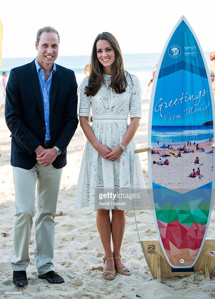 Catherine, Duchess of Cambridgeand Prince William, Duke of Cambridge pose with a surfboard they were given as they attend a lifesaving event on Manly Beach on April 18, 2014 in Sydney, Australia. The Duke and Duchess of Cambridge are on a three-week tour of Australia and New Zealand, the first official trip overseas with their son, Prince George of Cambridge.