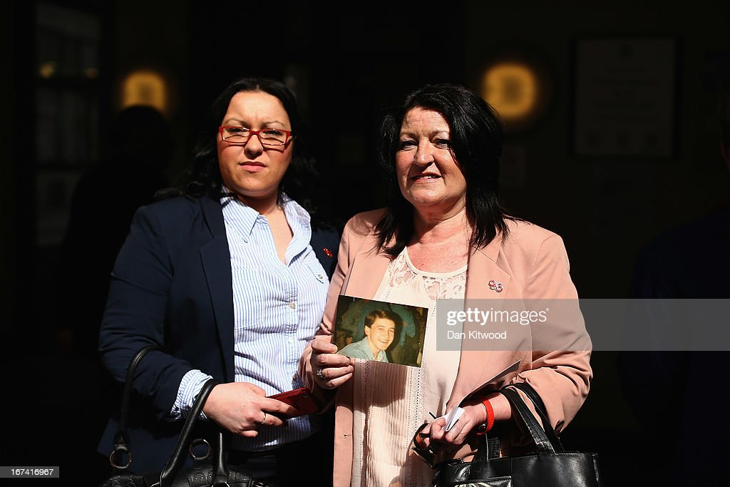 Catherine Foster (right) and Eveline McDonald-Mills, the niece and sister (left) of Peter McDonald-Mills join other families of the 96 football fans who lost their lives in the Hillsborough disaster at the Family Division of the High Court on April 25, 2013 in London, England. A hearing to decide the date and location of a new inquest into the 96 people who died in the Hillsborough disaster has begun in London. The Hillsborough disaster occurred during the FA Cup semi-final tie between Liverpool and Nottingham Forest football clubs in April 1989 at the Hillsborough Stadium in Sheffield, which resulted in the deaths of 96 football fans.