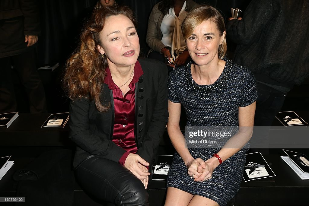 Catherine Frot and Anne Consigny attend the Alexis Mabille Fall/Winter 2013 Ready-to-Wear show as part of Paris Fashion Week on February 27, 2013 in Paris, France.