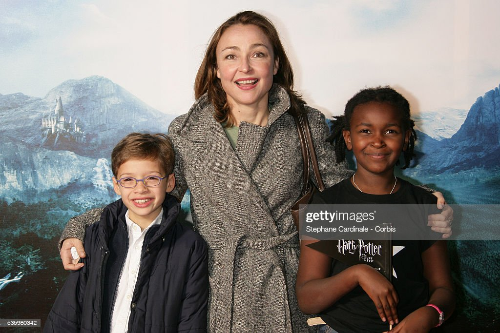 Catherine Frot with her chidren, Suzanne and Adam, attend the premiere of 'Harry Potter And The Goblet of Fire' in Paris.