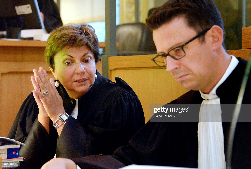 Catherine Glon (L) and Fabian Lahaie, lawyers of one of the three Somali pirates arrested by French soldiers in 2009 wait, on October 14, 2013 at Rennes' courthouse, prior to the opening hearing of the pirates' trial for hijacking a yacht in 2009. French troops stormed the Tanit sailboat on April 10, 2009 and captured the trio in a bid to free Florent Lemacon, his wife, their three-year-old son and two others.