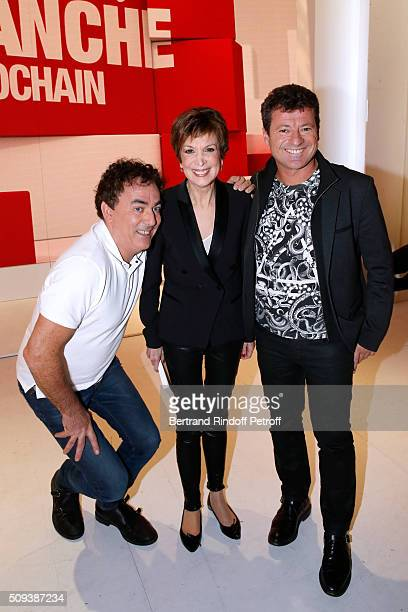 Catherine Laborde standing between Humorists 'Les Chevaliers du fiel' Francis Ginibre and Eric Carriere attend the 'Vivement Dimanche' French TV Show...