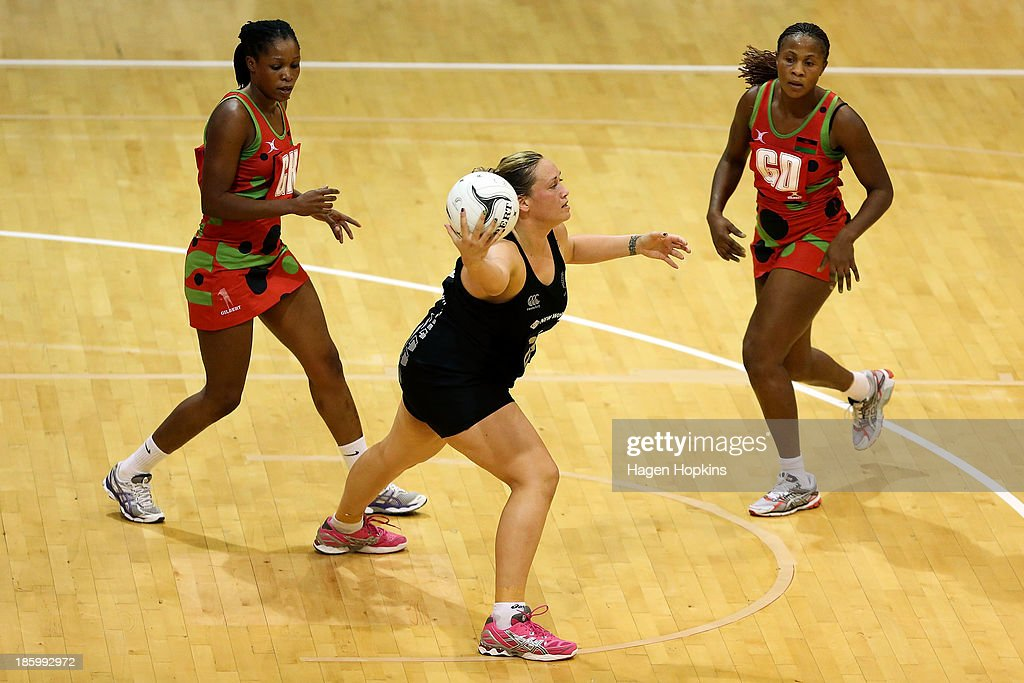 Catherine Latu of New Zealand receives a pass during the International Test Match between the New Zealand Silver Ferns and the Malawai Queens at Pettigrew Green Arena on October 27, 2013 in Napier, New Zealand.