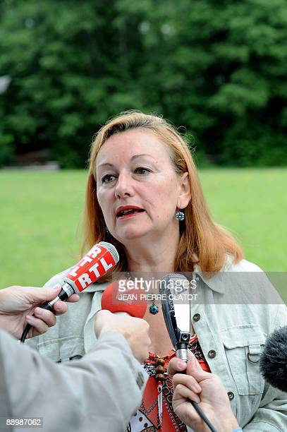 Catherine Le Gargasson member of French Bred bank work committe and mother of a child diagnosed with swine flu answers journalists' questions on July...