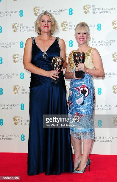 Catherine Martin and Beverley Dunn with the award for Production Design 'The Great Gatsby' at The EE British Academy Film Awards 2014 at the Royal...