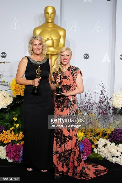 Catherine Martin and Beverley Dunn with the Best Achievement in Production Design award for 'The Great Gatsby' in the press room of the 86th Academy...