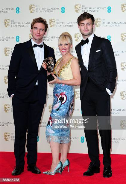 Catherine Martin with the award for Best Costume Design 'The Great Gatsby' alongside presenters Douglas Booth and Sam Claflin at The EE British...