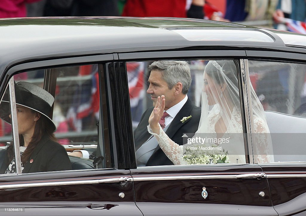 Catherine Middleton and her father Michael Middleton travel past Buckingham Palace as they make their way to the Royal Wedding of Prince William to...