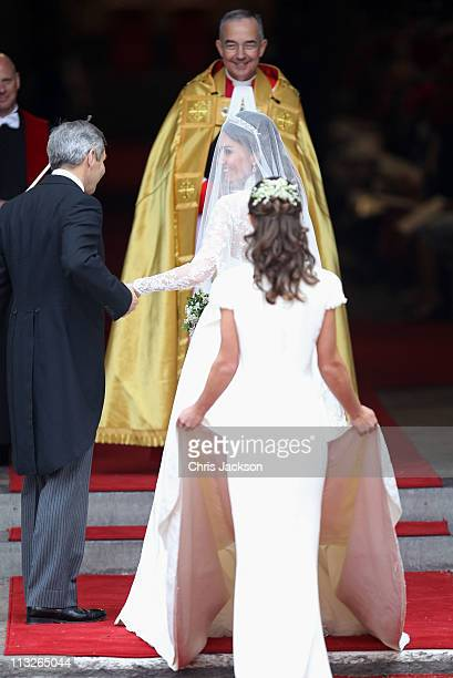 Catherine Middleton smiles with her father Michael Middleton and Maid of Honour Pippa Middleton as she is greeted by The Very Reverend Dr John Hall...