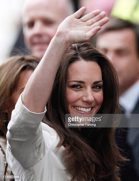 Catherine Middleton waves to the crowds as she arrives at The Goring Hotel with her sister Pippa after visiting Westminster Abbey on April 28 2011 in...