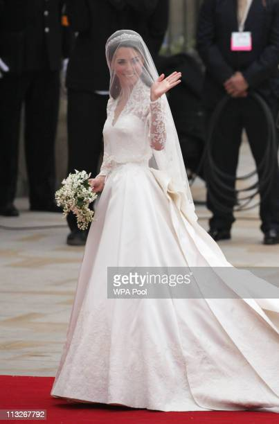 Catherine Middleton waves to the crowds as she arrives at Westmister Abbey on April 29 2011 in London England The marriage of Prince William the...