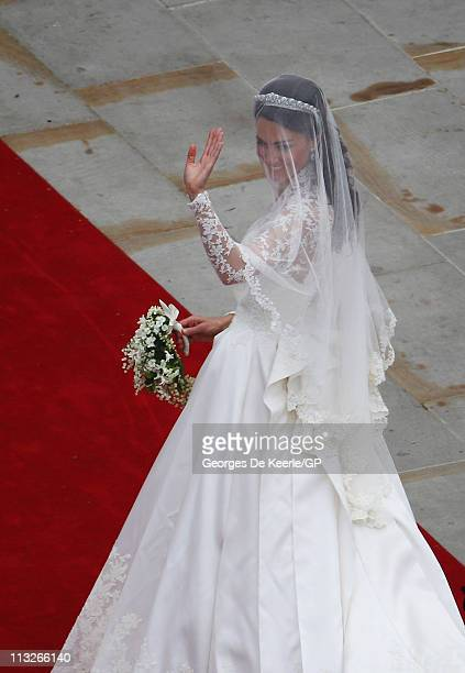 Catherine Middleton waves to the crowds as she arrives to attend her Royal Wedding to Prince William on April 29 2011 in London England The marriage...