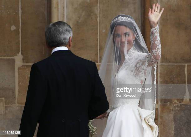 Catherine Middleton waves to the crowds as she arrives with her father Michael Middleton to attend the Royal Wedding of Prince William to Catherine...