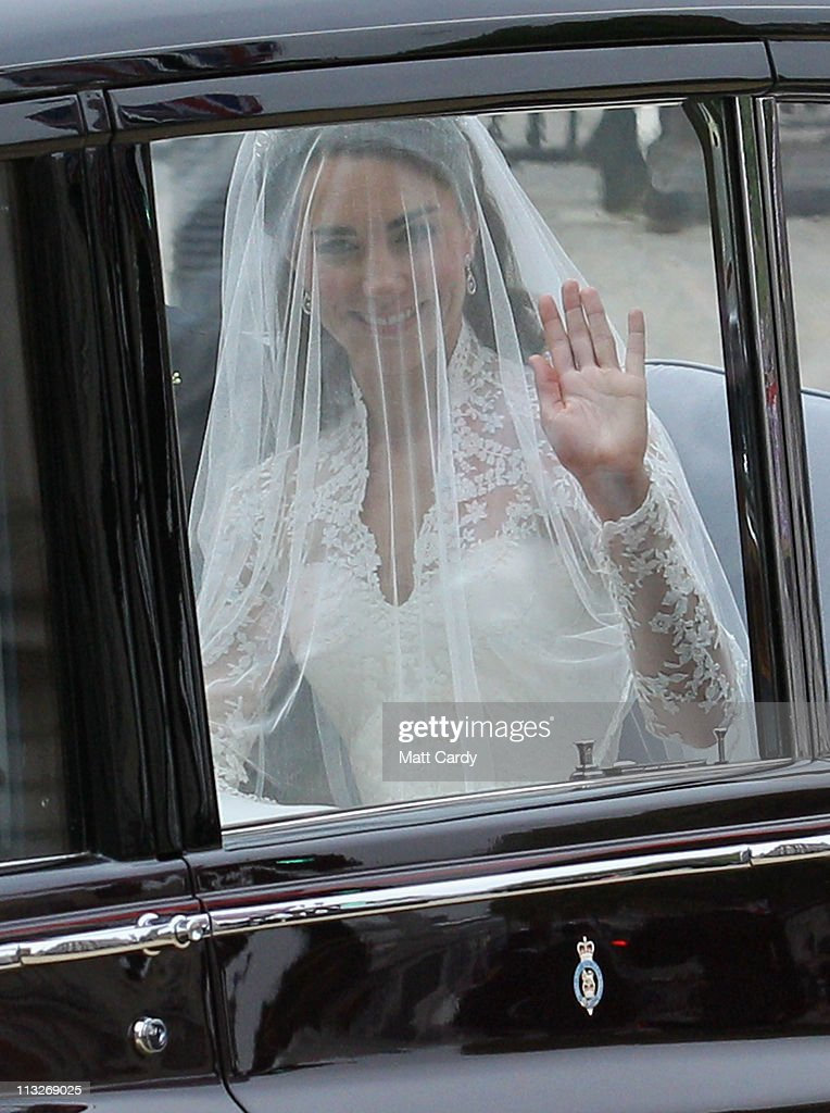 Catherine Middleton waves to the crowds as she makes her way along Horseguards to attend the Royal Wedding of Prince William to Catherine Middleton at Westminster Abbey on April 29, 2011 in London, England. The marriage of the second in line to the British throne is to be led by the Archbishop of Canterbury and will be attended by 1900 guests, including foreign Royal family members and heads of state. Thousands of well-wishers from around the world have also flocked to London to witness the spectacle and pageantry of the Royal Wedding.