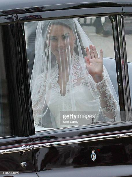 Catherine Middleton waves to the crowds as she makes her way along Horseguards to attend the Royal Wedding of Prince William to Catherine Middleton...