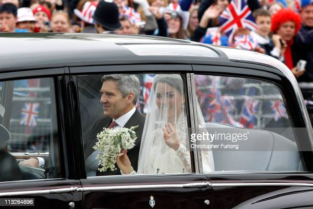 Catherine Middleton waves with the father Michael Middleton arrives to attend her Royal Wedding to Prince William of Wales at Westminster Abbey on...
