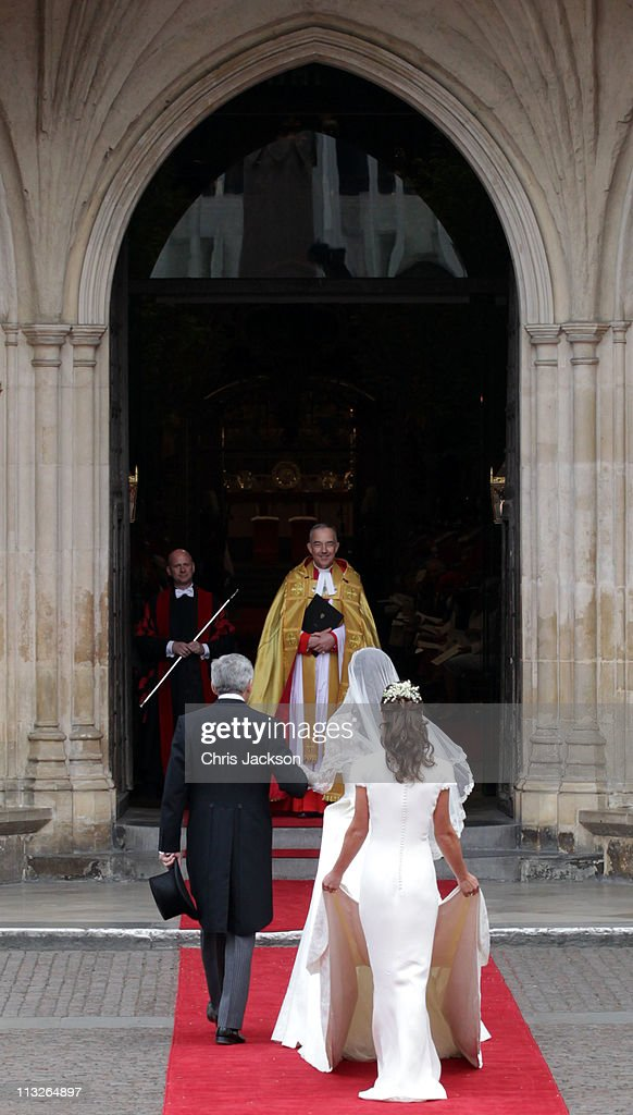 Catherine Middleton with her father Michael Middleton and Maid of Honour Pippa Middleton is greeted by The Very Reverend Dr John Hall Dean of...