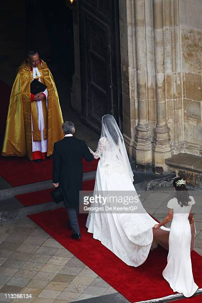 Catherine Middleton with her father Michael Middleton and Maid of Honour Pippa Middleton are greeted by The Very Reverend Dr John Hall Dean of...