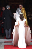 Catherine Middleton with the father Michael Middleton and Maid of Honour Pippa Middleton is greeted by The Very Reverend Dr John Hall Dean of...