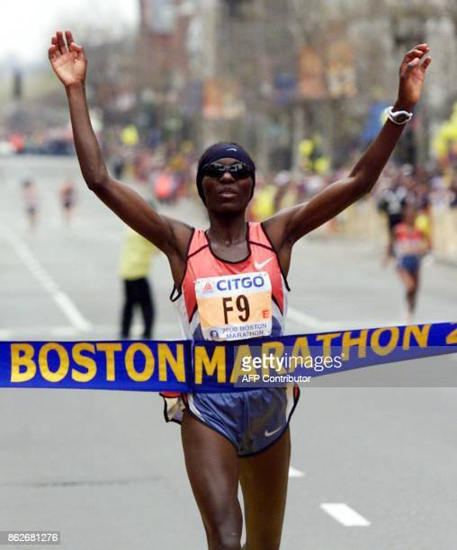 Catherine Ndereba of Kenya crosses the finish line to win the woman's division of the 104th running of the Boston Marathon in Boston 17 April 2000...