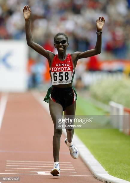 Catherine Ndereba of Kenya finishes first for the gold in the women's marathon ahead of Japanese runners Mizuki Noguchi who won silver and Masako...