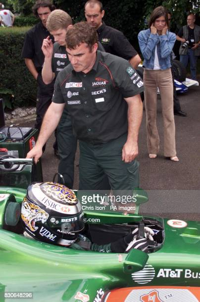Catherine Rice the girlfriend of Irish formula one driver Eddie Irvine plugs her ears as he starts his Jaguar at the Goodwood Festival of Speed The...
