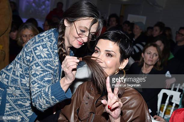 Catherine Ringer makes a moustache with hair to Cristina Cordula during the Jean Paul Gaultier Haute Couture Spring Summer 2017 show as part of Paris...