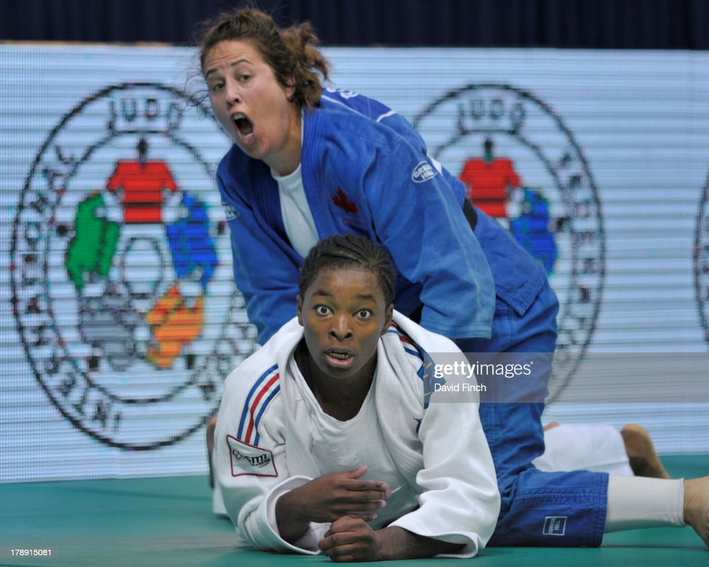 Catherine Roberge of Canada (blue) threw former world champion, <a gi-track='captionPersonalityLinkClicked' href=/galleries/search?phrase=Audrey+Tcheumeo&family=editorial&specificpeople=7079672 ng-click='$event.stopPropagation()'>Audrey Tcheumeo</a> of France, for ippon to reach the u78kgs semi-final during the Rio World Judo Championships on Day 5 at the Gympasium Maracanazinho August 30, 2013 in Rio de Janeiro, Brazil.