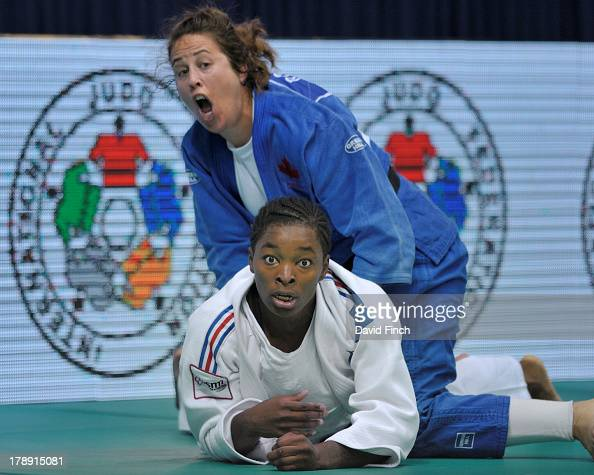 Catherine Roberge of Canada threw former world champion Audrey Tcheumeo of France for ippon to reach the u78kgs semifinal during the Rio World Judo...