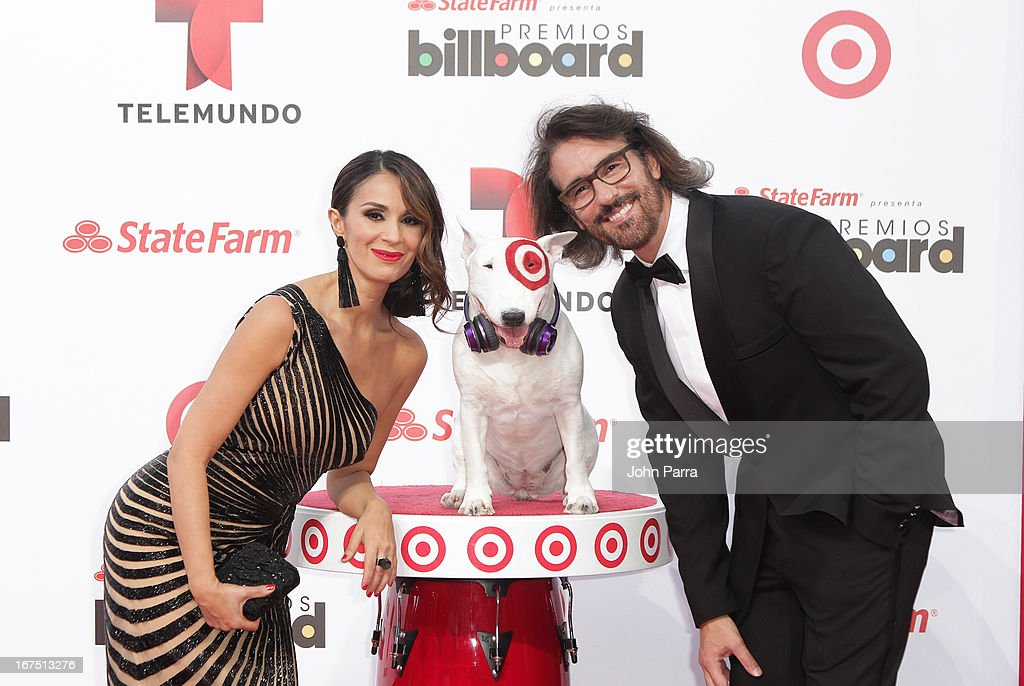 Catherine Siachoque and Miguel Varoni celebrates with Bullseye, Target's Beloved Bull Terrier Mascot, at the 2013 Billboard Latin Music Awards at BankUnited Center on April 25, 2013 in Miami, Florida.