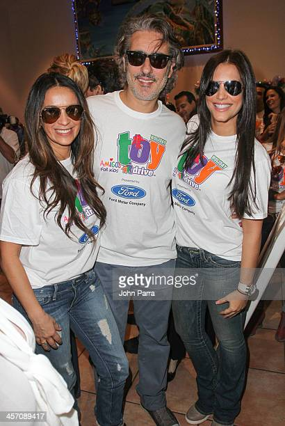 Catherine Siachoque Miguel Veroni and Gaby Espino participate in Amigos For Kids 21st Annual Holiday Toy Drive on December 15 2013 in Miami Florida